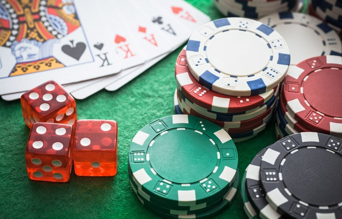 gambling with cards, dice, and chips