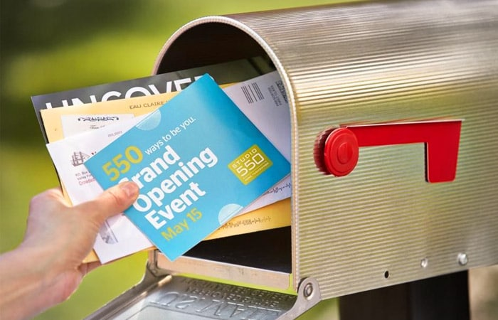 putting direct mail in mailbox