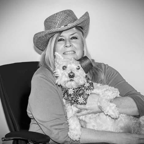 Debbie Jennings holding her dog Sadie