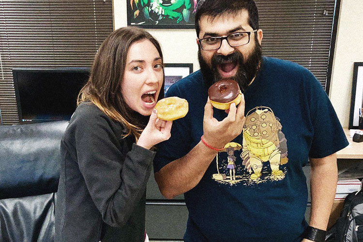 Cheryl and Jigar eating donuts