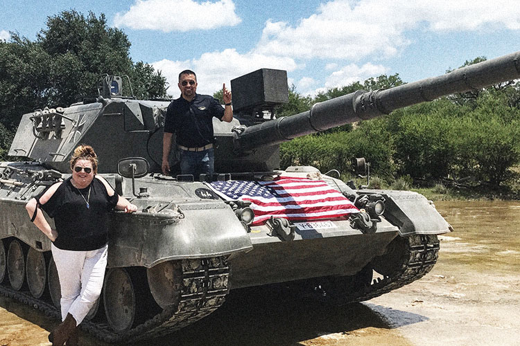 Jenni and Alex with a tank