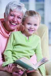 Grandmother Reading with Granddaughter --- Image by © Royalty-Free/Corbis