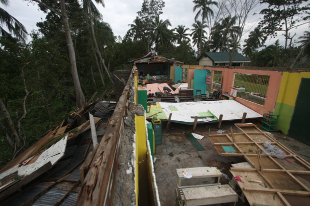 Strong winds brought by Typhoon Pablo blew away the entire roof of a three-classroom building of Mipangi Elementary School in Nabunturan, Compostela Valley province on Tuesday (4 Dec 2012). Mindanews Photo by Ruby Thursday More