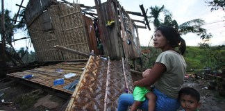 BLEAK FUTURE. Mary Grace Magadan, 30, and her children outside her parent's house in Laak town in Compostela Valley province on Dec. 8, 2012, which was destroyed by Typhoon Pablo. MindaNews photo by Ruby Thursday More