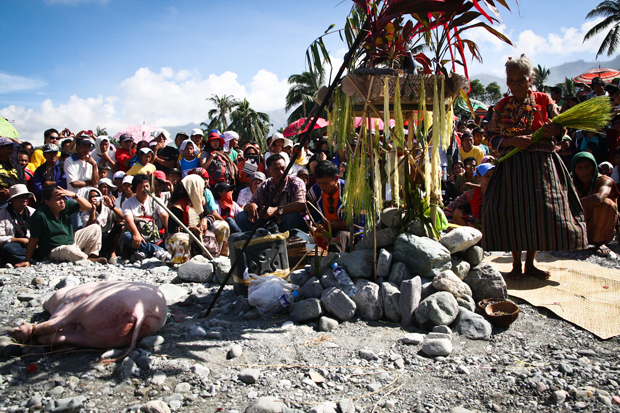 Indigenous peoples hold a ritual on the rocks, in the site which used to be the center of Barangay Andap in New Bataan, Compostela Valley Province on Monday on the 41st day since December 4, 2012. MindaNews Photo by Ruby Thursday More