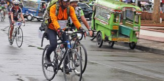 "Fr. Amado ""Picx"" Picardal arrives in Cagayan de Oro City, accompanied by cyclists from Malaybalay City, Bukidnon on Dec. 22, 2014. From Cagayan de Oro, Picardal will pedal to Iligan City, the last leg of his ""Climate Ride"", a campaign to boost awareness on climate change and its impact. The priest's 14-day tour started in Baclaran, Manila and passed through Leyte island. MindaNews photo by Froilan Gallardo"