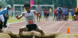 An athlete lands on the sand during the opening game of the long jump at the Palarong Pambansa in Tagum City, Davao del Norte on Sunday, May3. Mindanews Photo by Keith Bacongco