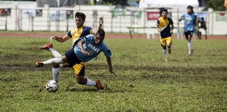 Players fight for the ball in the championship match on Saturday of the secondary football game between National Capital Region and Western Visayas Region during the Palarong Pambansa in Tagum City, Davao del Norte. Western Visayas Region captured its first ever crown in secondary football after a shootout. MindaNews photo by Keith Bacongco