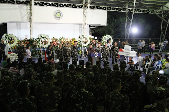 "President Rodrigo Duterte speaks before the families of the four slain soldiers and troops at the covered court of the the Eastern  Mindanao Command in Davao City shortly past midnight Sunday, August 7, 2016, where he warned the National Democratic Front to stop using landmines ""or we stop talking (and) fight another 45 years.""  Mindanews Photo"