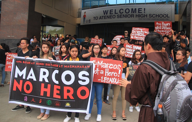 """Students of Ateneo de Davao University stage a protest action Wednesday against the Nov. 18 burial of the remains of the deposed dictator Ferdinand Edralin Marcos at the Libingan ng mga Bayani, in preparation for the """"National Day of Rage and Unity"""" on Friday at the Freedom Park. MindaNews photo by Gregorio Bueno"""