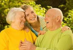 Elderly couple with lady smiling