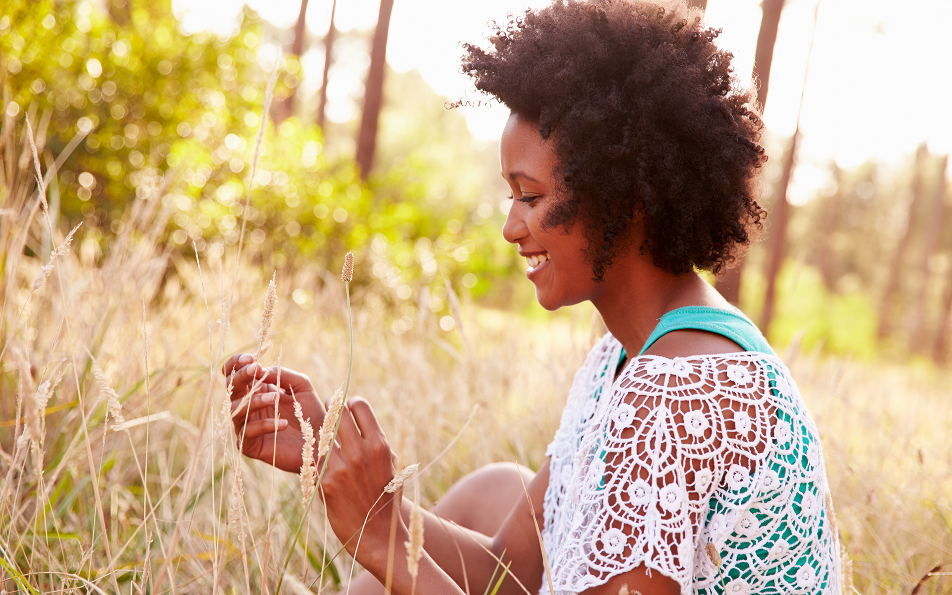 12-Minute Meditation to Cultivate Presence and Awareness - Portrait Of Smiling Young Woman Sitting In Countryside