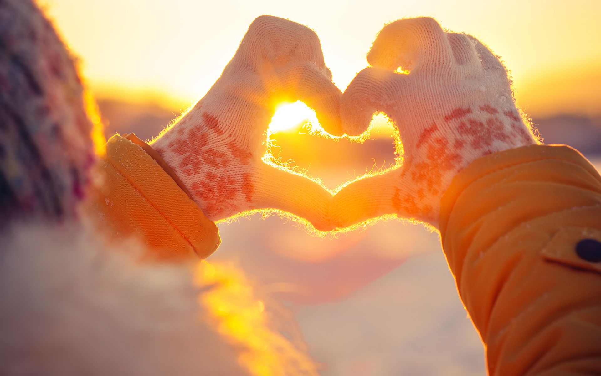 3 Mindful Practices to Deepen Your Connections - Woman hands in winter gloves making a heart shape