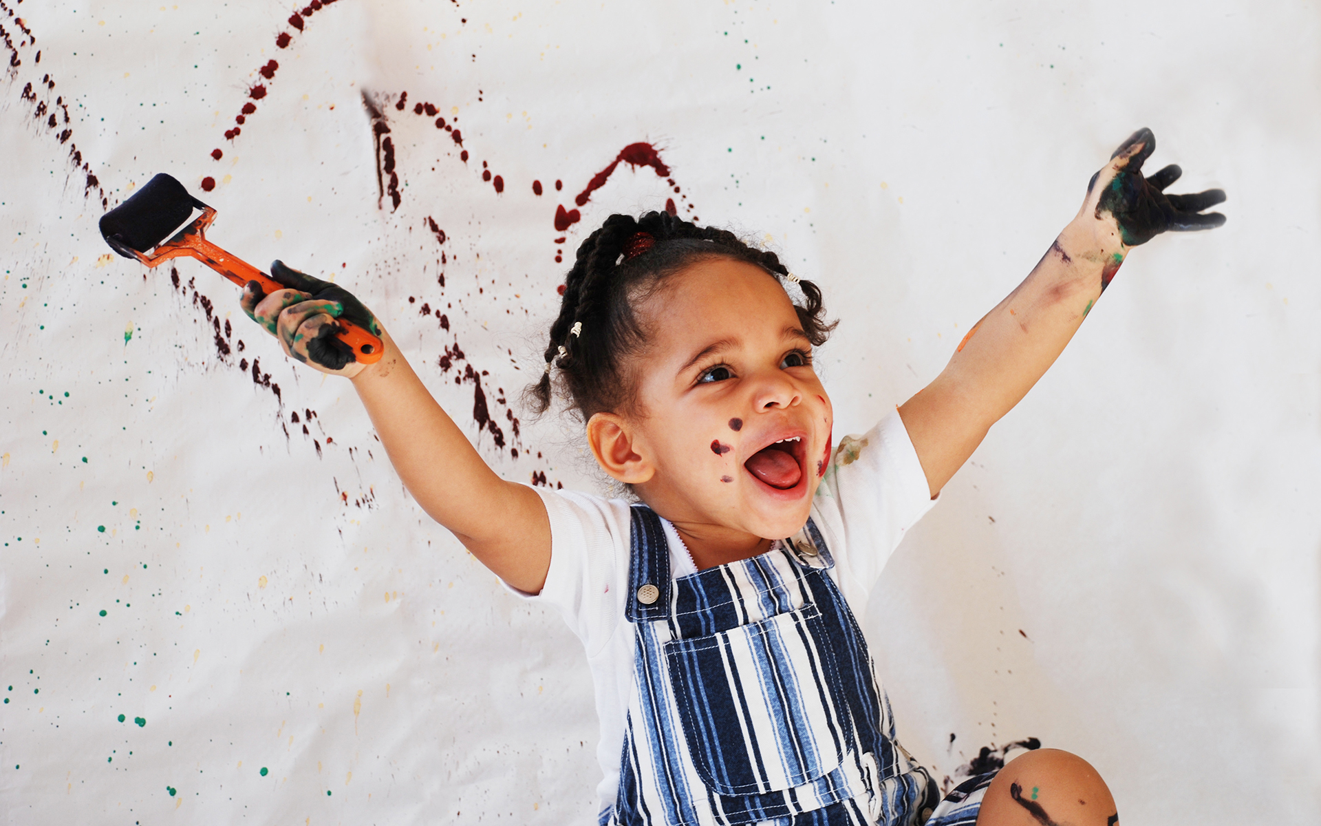 Helping children embrace big emotions - Happy little girl painting