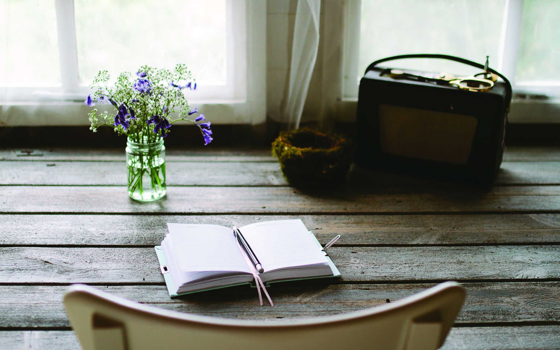 How to Start a Mindful Journaling Practice - An open journal sits open on a desk