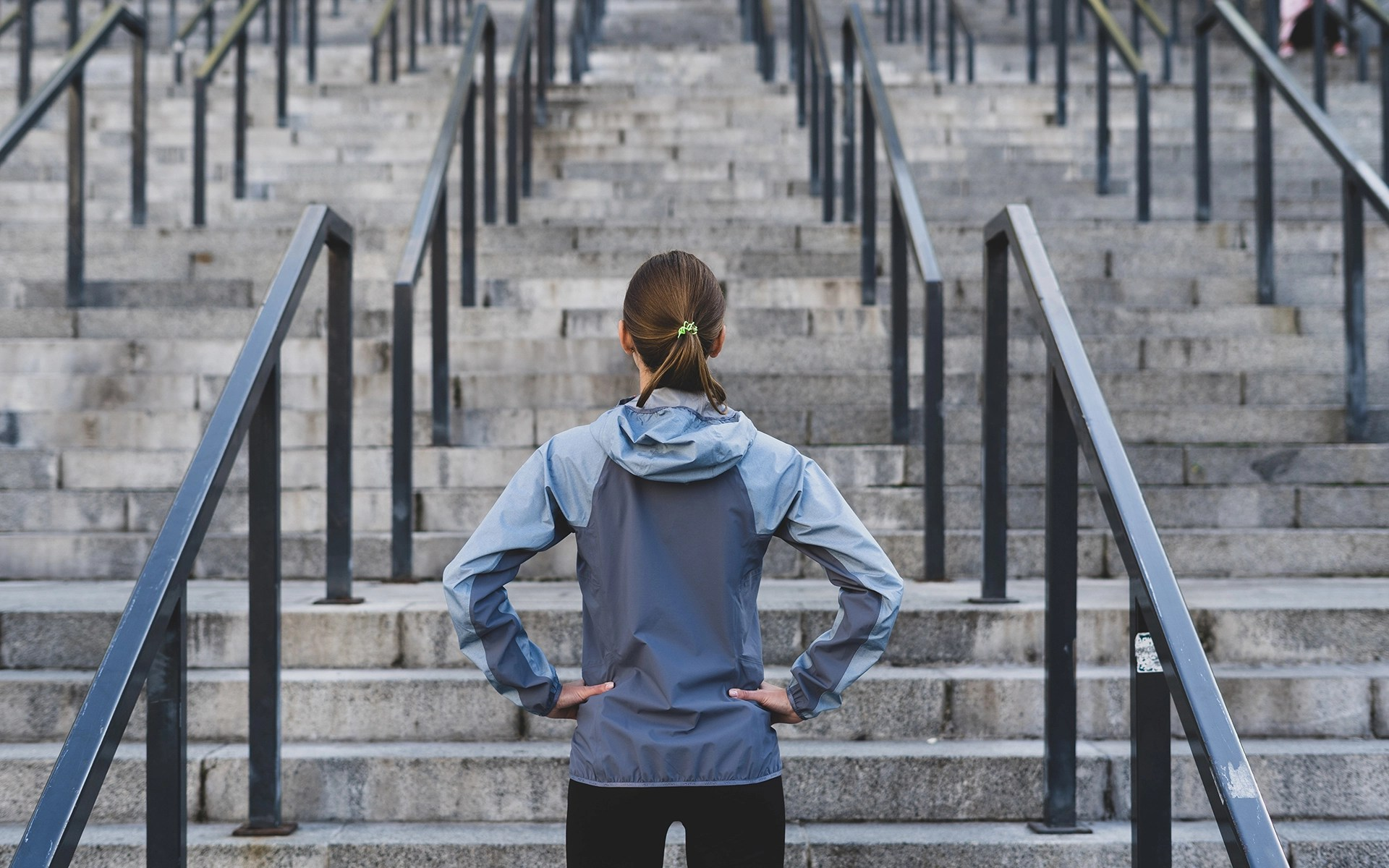 Woman stands in front stairs - Five ways to manage adversity