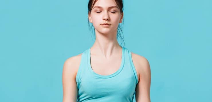 woman meditating, eyes closed
