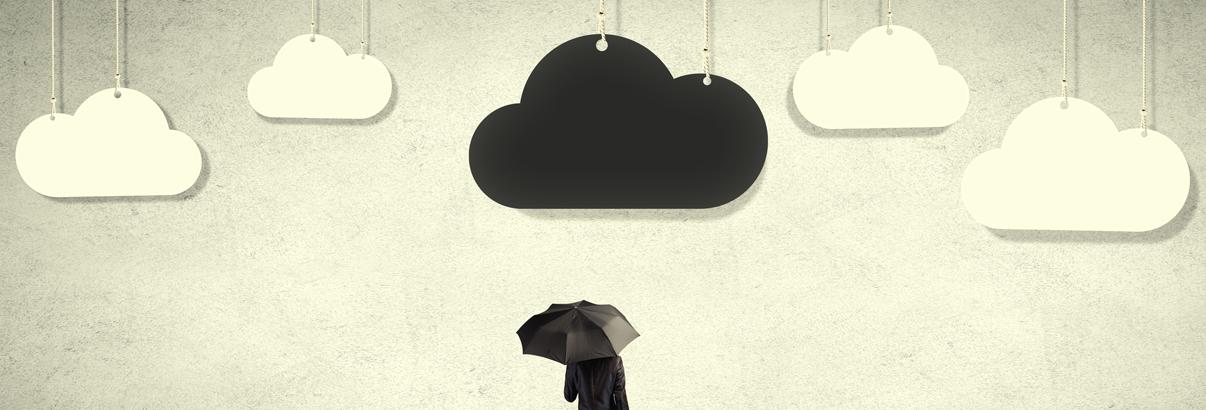 man standing under clouds with umbrella