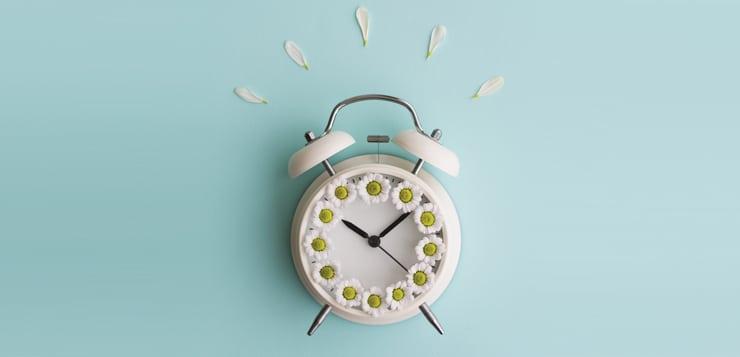 alarm clock with flower petals on top