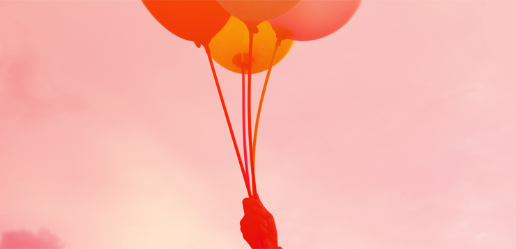 hand holding balloons