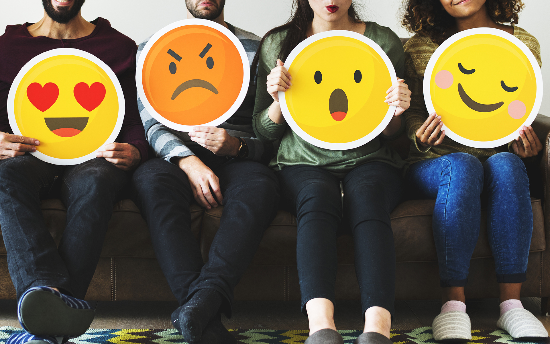 Making Friends with Difficult Emotions - Group of diverse people holding emoticon icons