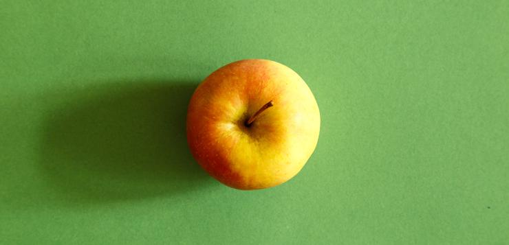 apple on green surface