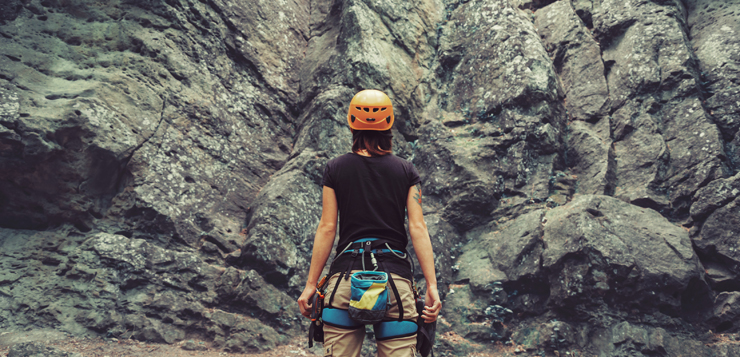 woman about to climb rocks