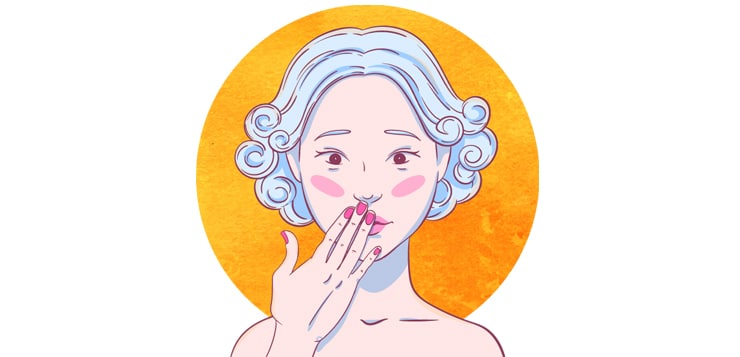 woman blushing, holding hand over mouth, looking embarrassed