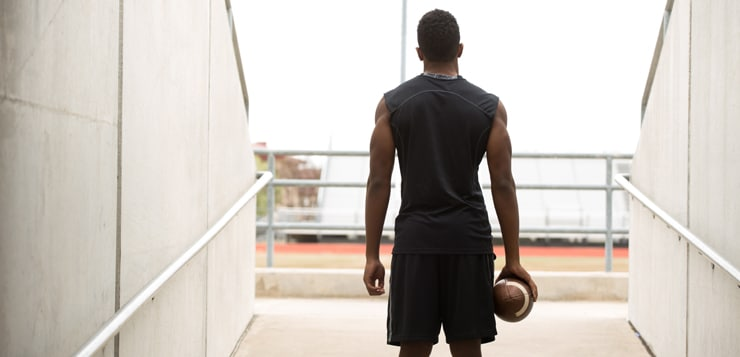 Rear view of a football player