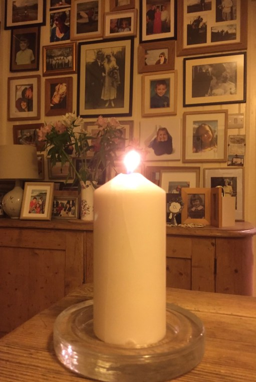 Let There be Light: Lighting a Candle for Diddley in Laurel Cottage.