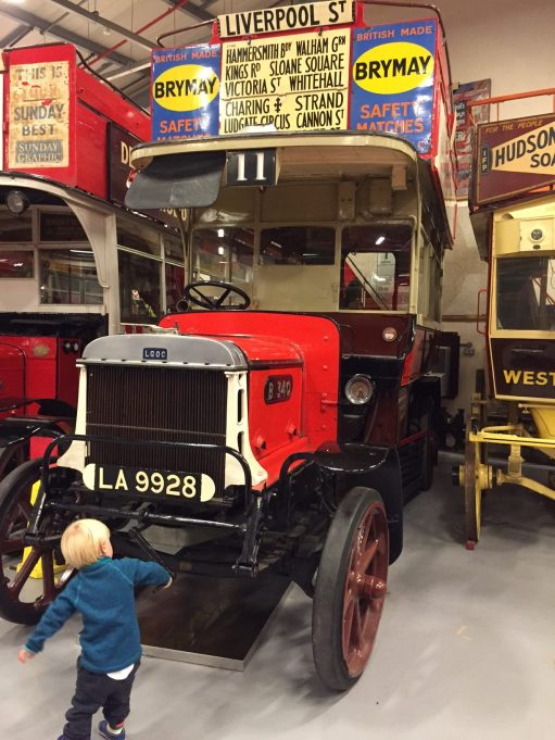 London Transport Museum: Well before Bobby, this. LA 9928. LGOC B-type bus B340. Solid tyres and a very young chap trying to turn the engine.