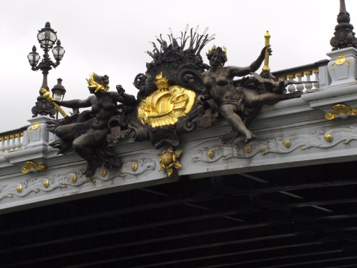 Paris: Close-up of a crest on the Pont Alexandre III.