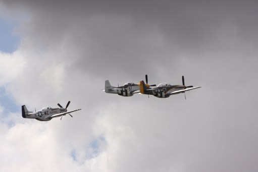 Flying Legends, Duxford. Three Mustangs. Big Beautiful Doll to left.