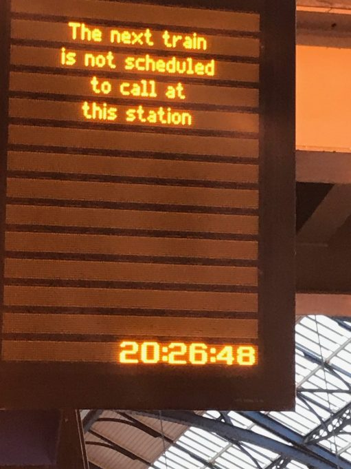 """Brighton: Sign reads: """"The next train is not scheduled to call at this station""""!"""