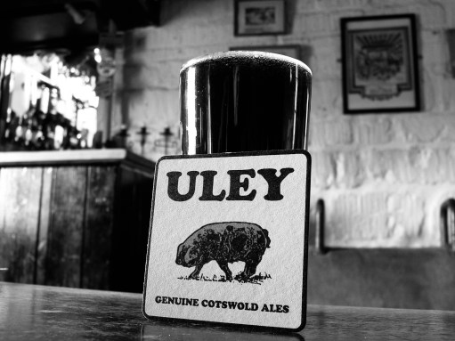 "Cotswold Granny: Uley beer. Genuine Cotswold Ale. Brewed at Dursley. ""Old Spot"" at the Woolpack."