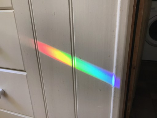 The Kitchen Window: The rainbow on the cupboard.