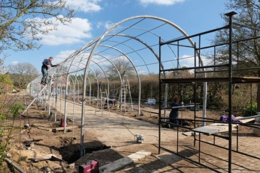 Just Two Hours: New wisteria tunnel under construction.