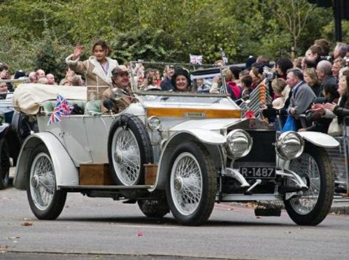 Special One: And finally, or rather now at last, a Princess in that wonderful car. Treated like royalty by Tim and Susie in front. The King is thereabouts in the back, acknowledging his subjects. In case anyone came from Mauritania.