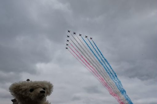 RAF 100: The crowds clapped and cheered the final glorious sight of the Red Arrows trailing red, white and blue smoke right over Buckingham Palace.