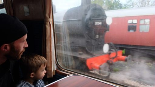 """From a Railway Carriage"". A boy and his Dad."