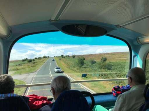 Tick tock. Ride upstairs on a double decker bus. North Yorkshire Moors.