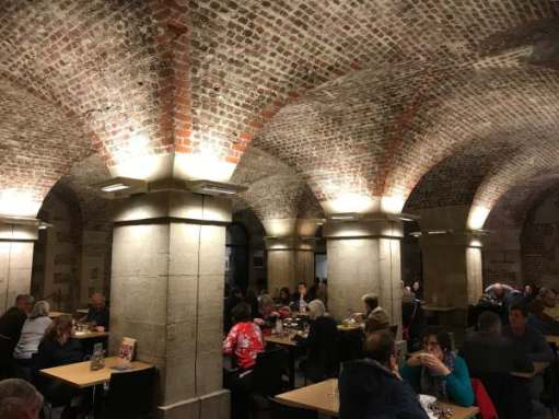 Tick tock. Eat Apple Crumble and Custard in a crypt. St Martin's in the Fields, London.