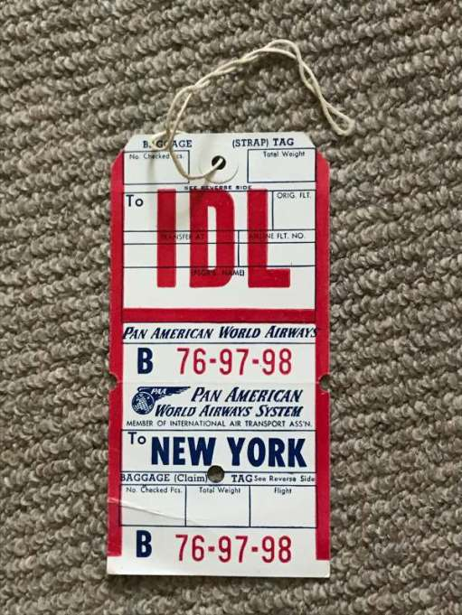 """Tie on Baggage Labels: """"IDL"""" stands for Idlewild . New York's airport that was later renamed John F Kennedy in 1963."""