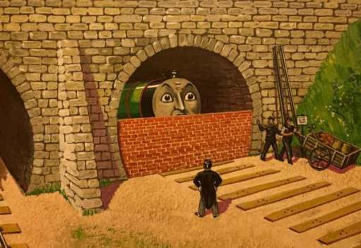 Henry bricked up in the tunnel, but able to see over the wall.