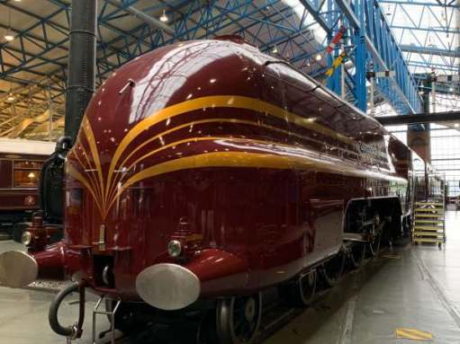 "Duchess of Hamilton. A beautiful maroon streamlined steam engine, with yellow/gold ""cats' whiskers"" painted for effect. The front is rounded."