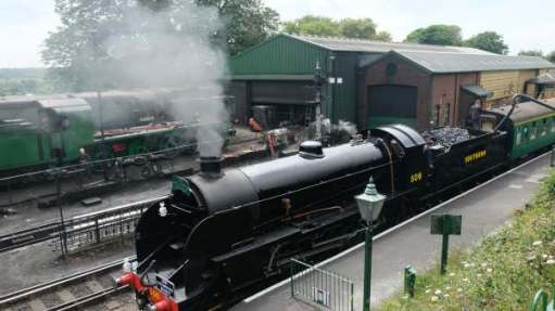 First train at Ropley. Topping 30506 (now 506) up with water.