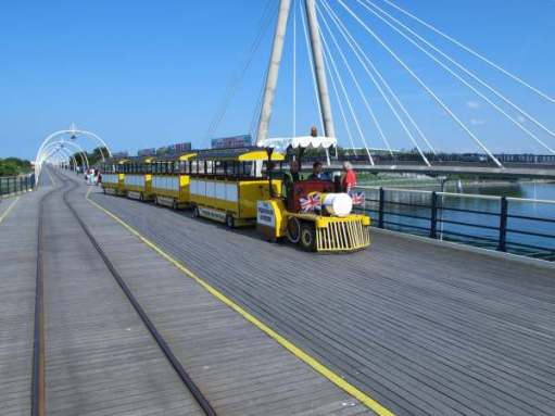 Noddy train on Southport Pier, with the rails for the normal train alongside.