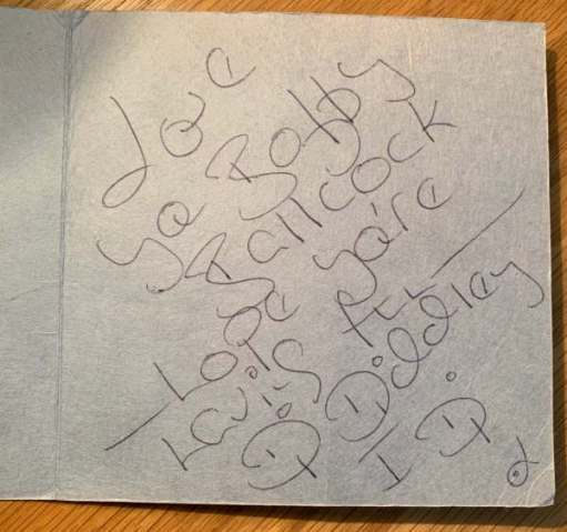Inside of the card, with a handwritten message: Love you Bobby Ballcock - Hope you're having fun. Diddley.