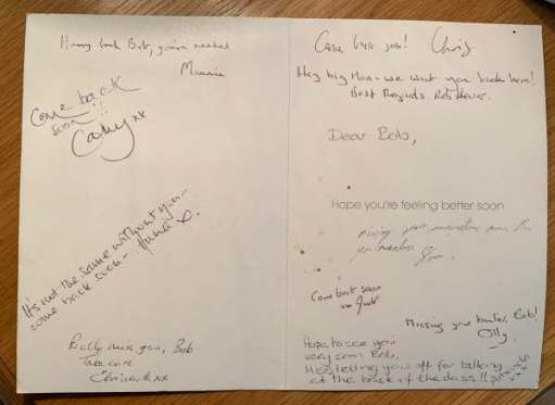 The inside of the Get Well Soon card, with various hand-written messages to Bob from colleagues.
