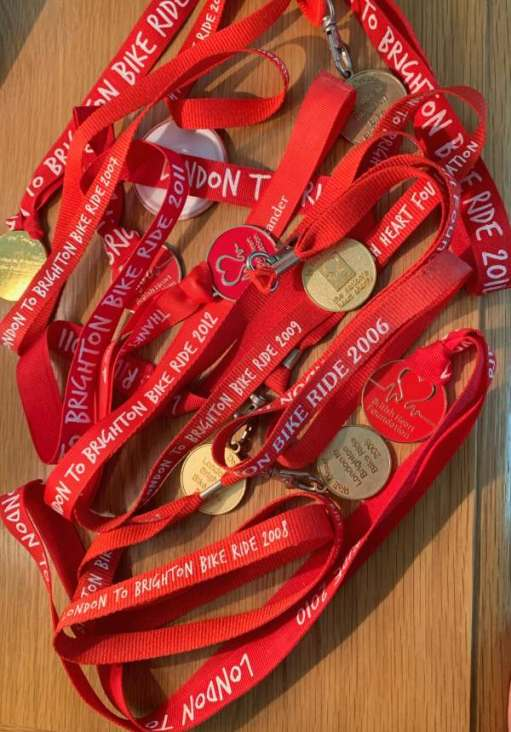 A collection of medals from several years for the London to Brighton Bike Ride. All on red lanyards.